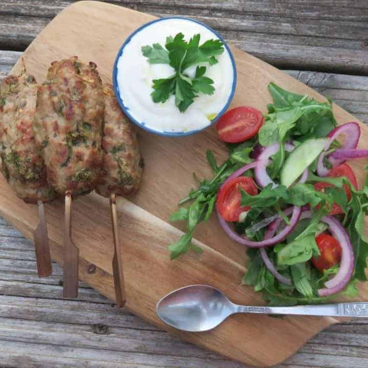 Lean pork koftas with garlic yoghurt dip and rocket salad