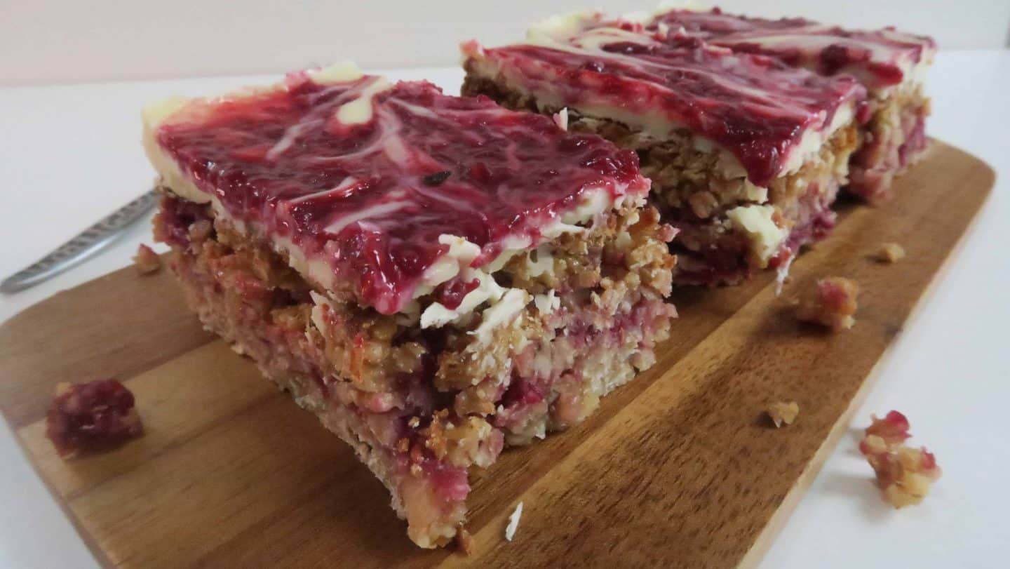 Gluten free white chocolate and raspberry flapjacks for Pink Pants Tea Party Month